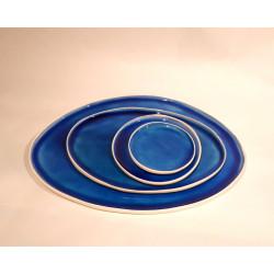 Blue eye, quatre plats émaillés