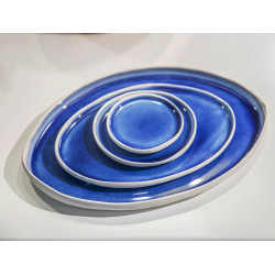 Blue eye, four glazed plates